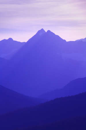 Hazy layered mountain scene   Imagens