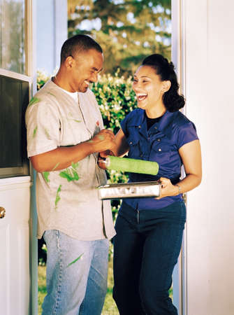 Couple laughing over spilled paint Stock Photo - 7559452