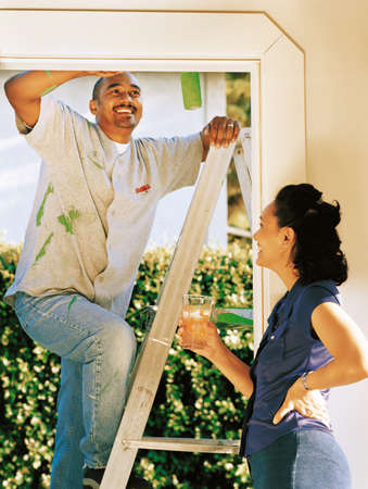 Couple painting doorway Stock Photo - 7559480
