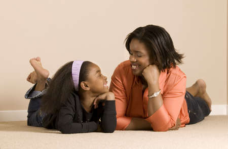 Mom and daughter relaxing together Stock Photo - 7559329