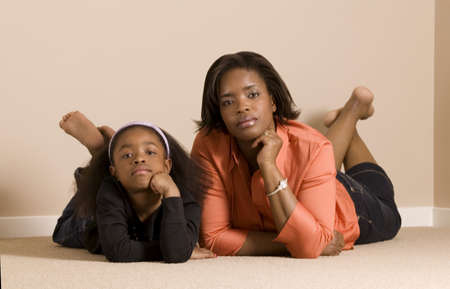 Mom and daughter looking very serious Stock Photo - 7559315