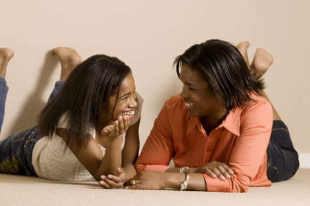 Mom and daughter relaxing together Stock Photo - 7559331