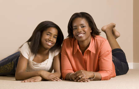 Mother and daughter laying on the floor smiling and posing Stock Photo - 7559299