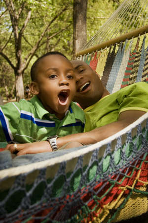 Father and son relaxing and laughing Stock Photo - 7559351