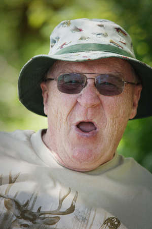 outdoorsman: Senior man making a silly face