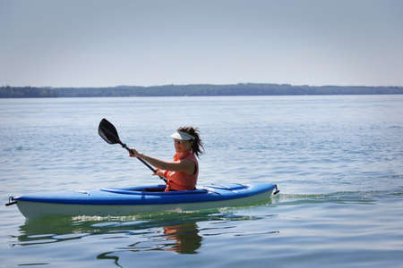 Woman kayaking Stock Photo - 7559245