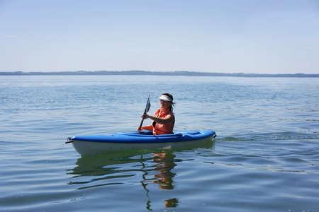 30 something women: Woman kayaking