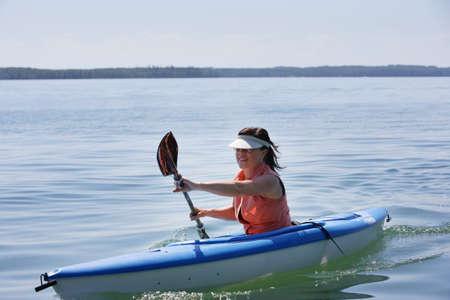 Woman kayaking Stock Photo - 7559241