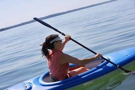 Woman kayaking Stock Photo - 7559243
