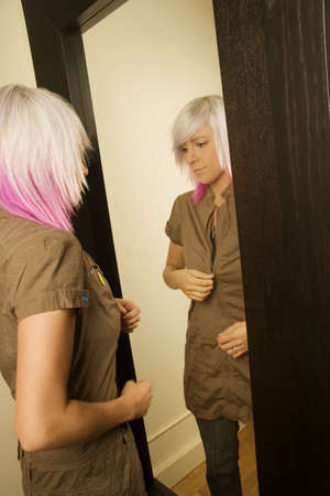 Woman dressing in front of mirror Stock Photo - 7559300