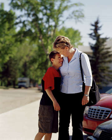 Woman smiling and hugging son Stock Photo - 7559355