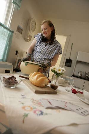 Woman in the kitchen on the phone Stock Photo - 7559434
