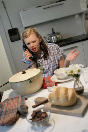 Woman in a 1940's style kitchen Stock Photo - 7559414