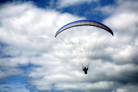 A hang glider on a cloudy day Stock Photo - 7559408