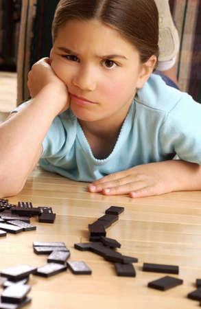 dominoes: Girl playing dominoes