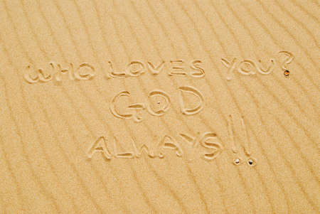 gods: Writing in sand that states, who loves you? GOD, always