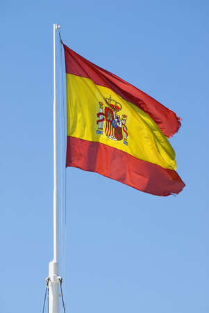 Mast bearing the Spanish national flag   Stock Photo - 7559262