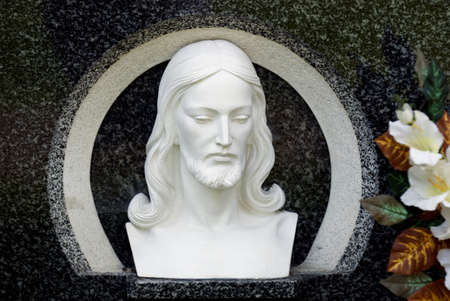 grave site: Carved image of Christs head