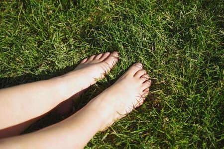Bare feet on grass Stock Photo - 7559465
