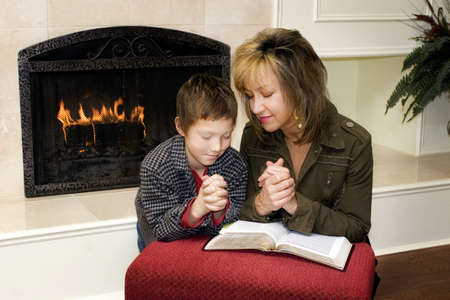 Mother and son praying together Stock Photo - 7559512