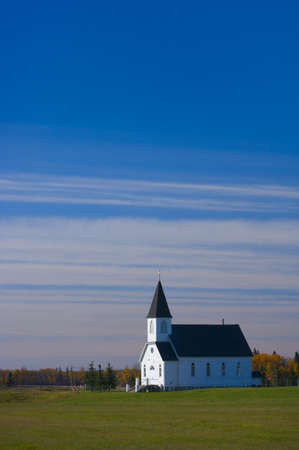 Traditional prairie steeple church in the morning   Banco de Imagens