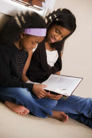 Sisters reading the Bible Stock Photo - 7559369