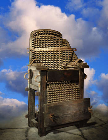 don hammond: Electric chair against a background of clouds