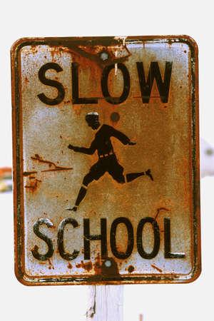 Rusty school zone sign