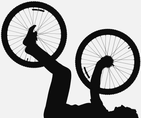 corey hochachka: Silhouette of person holding bicycle wheel