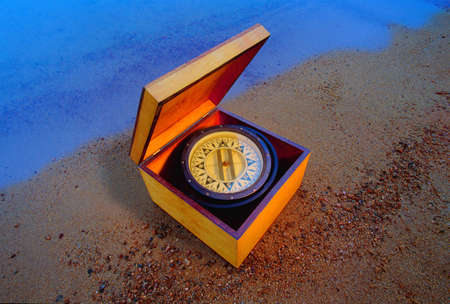 don hammond: Compass in a box on the beach