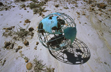 don hammond: Wire globe outside on sand
