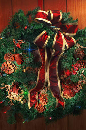 corey hochachka: Christmas wreath with pinecones and bow Stock Photo
