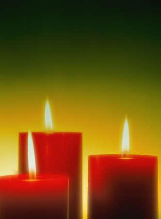 carson ganci: Three lit candles