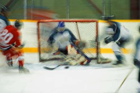Hockey player shooting on goal photo