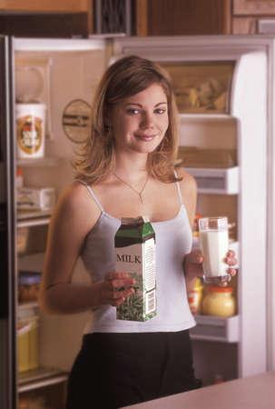 Girl getting glass of milk from fridge Stock Photo - 8242761
