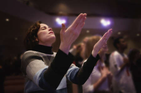 Woman with upraised hands