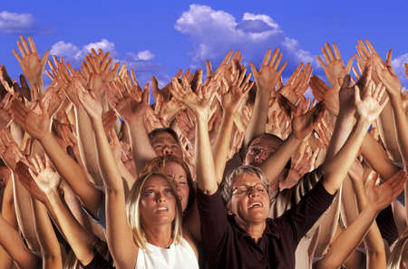 praise: Many hands raised in worship Stock Photo