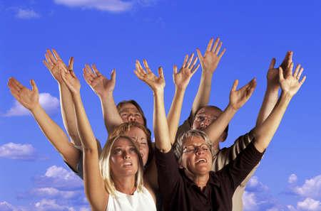 Hands raised in worship photo