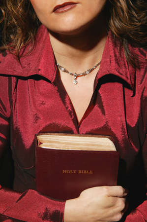 righteous: Woman holding a Bible