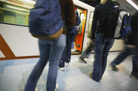 disembark: Passengers getting on and off subway Stock Photo