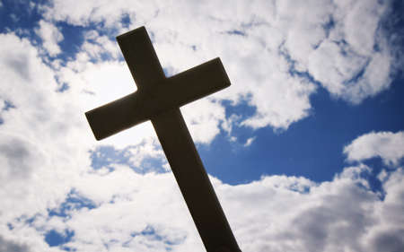A cross silhouetted against clouds Stock Photo - 8241914