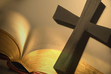 bible and cross: Cross with open bible Stock Photo