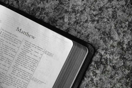 muz: Bible open to Matthew