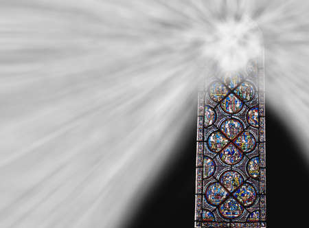 cathedrals: Chartres cathedral stained glass window with light shining through Stock Photo
