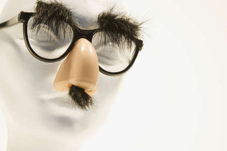 'hide out': Mannequin wearing groucho glasses Stock Photo