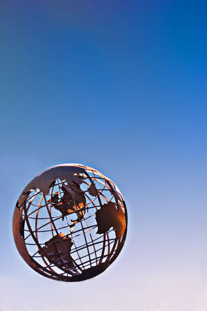 Terrestrial globe on blue background