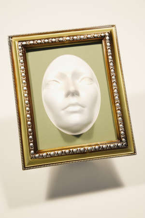 cor: Mask in a picture frame Stock Photo