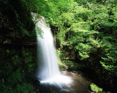 co action: Glencar Waterfall, Co. Antrim, Ireland Stock Photo