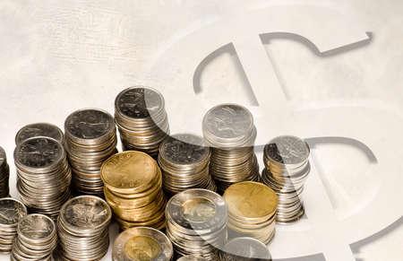 Money sign on top of coins Standard-Bild