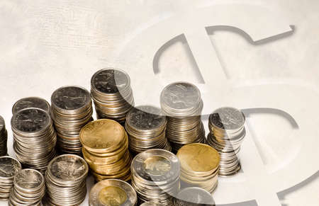heap: Money sign on top of coins Stock Photo